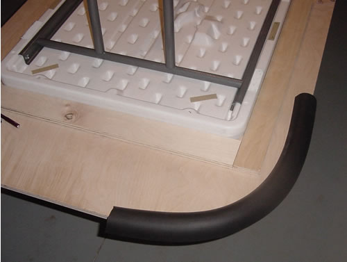 Padded railing clearance for poker table